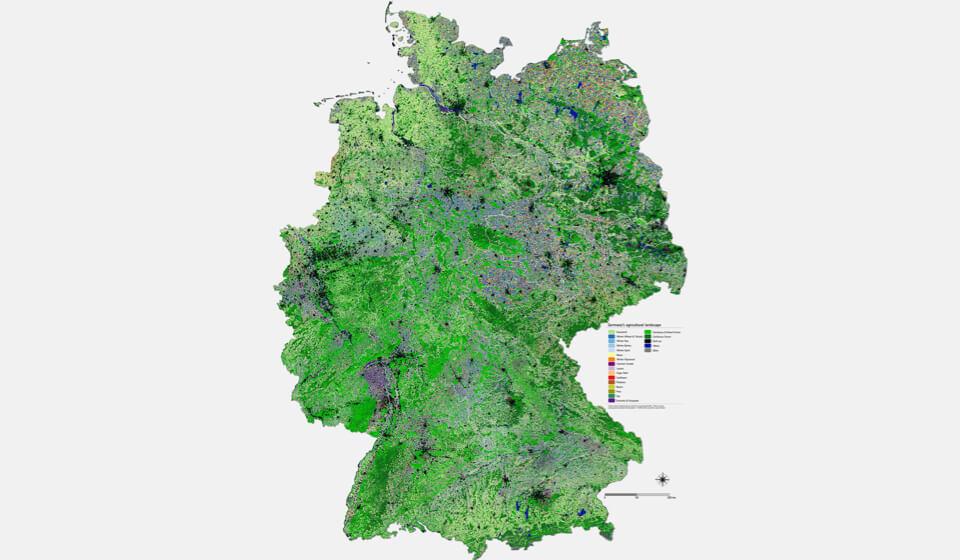 Deutschlandkarte mit einem Flickenteppich bunt dargestellter landwirtschaftlichen Flächen.